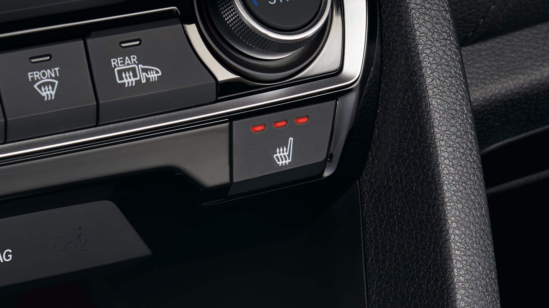 Heated front seat buttons detail in the 2020 Honda Civic Touring Sedan.