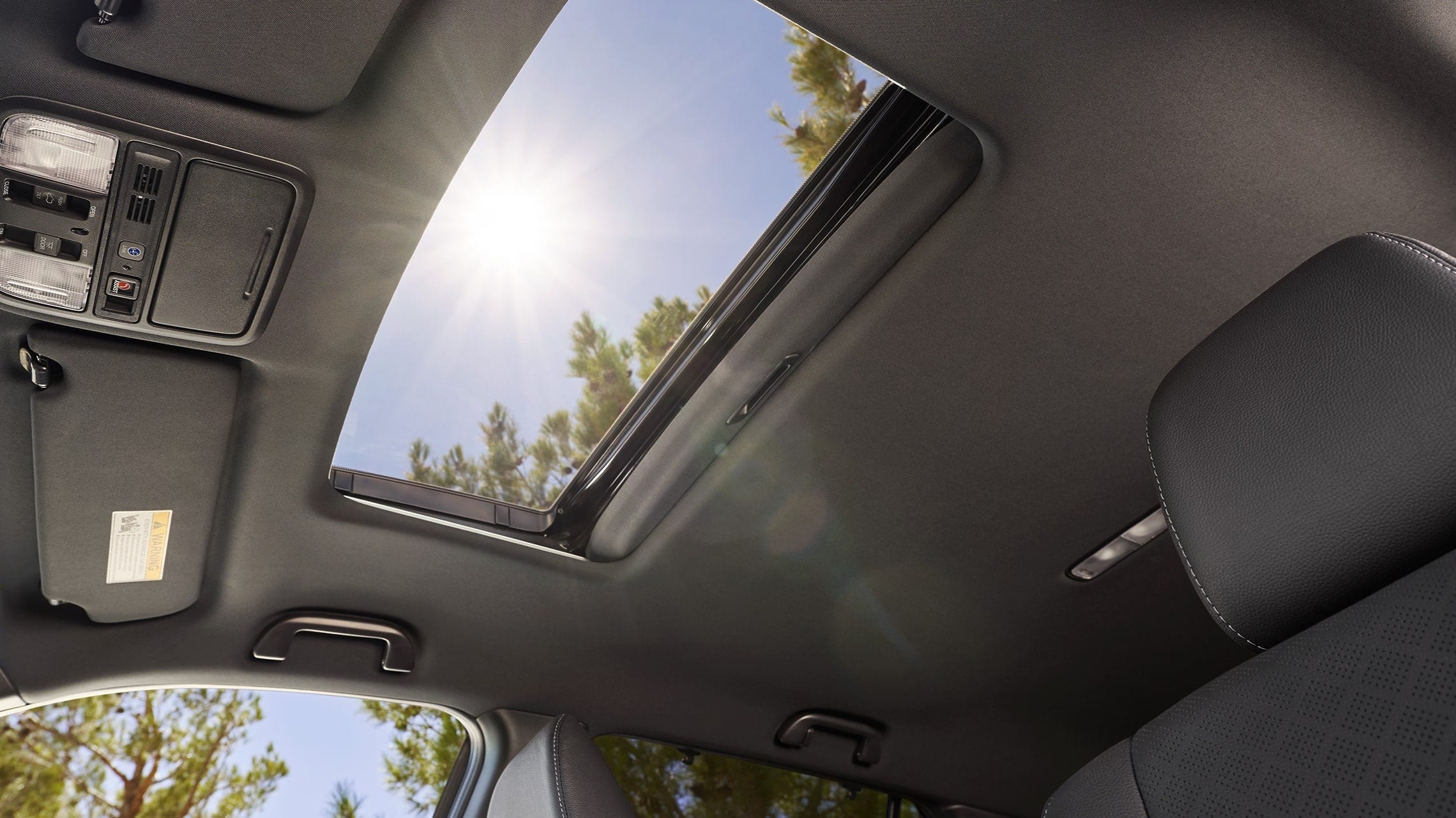 Interior view with one-touch power moonroof detail on the 2019 Honda Passport Elite.