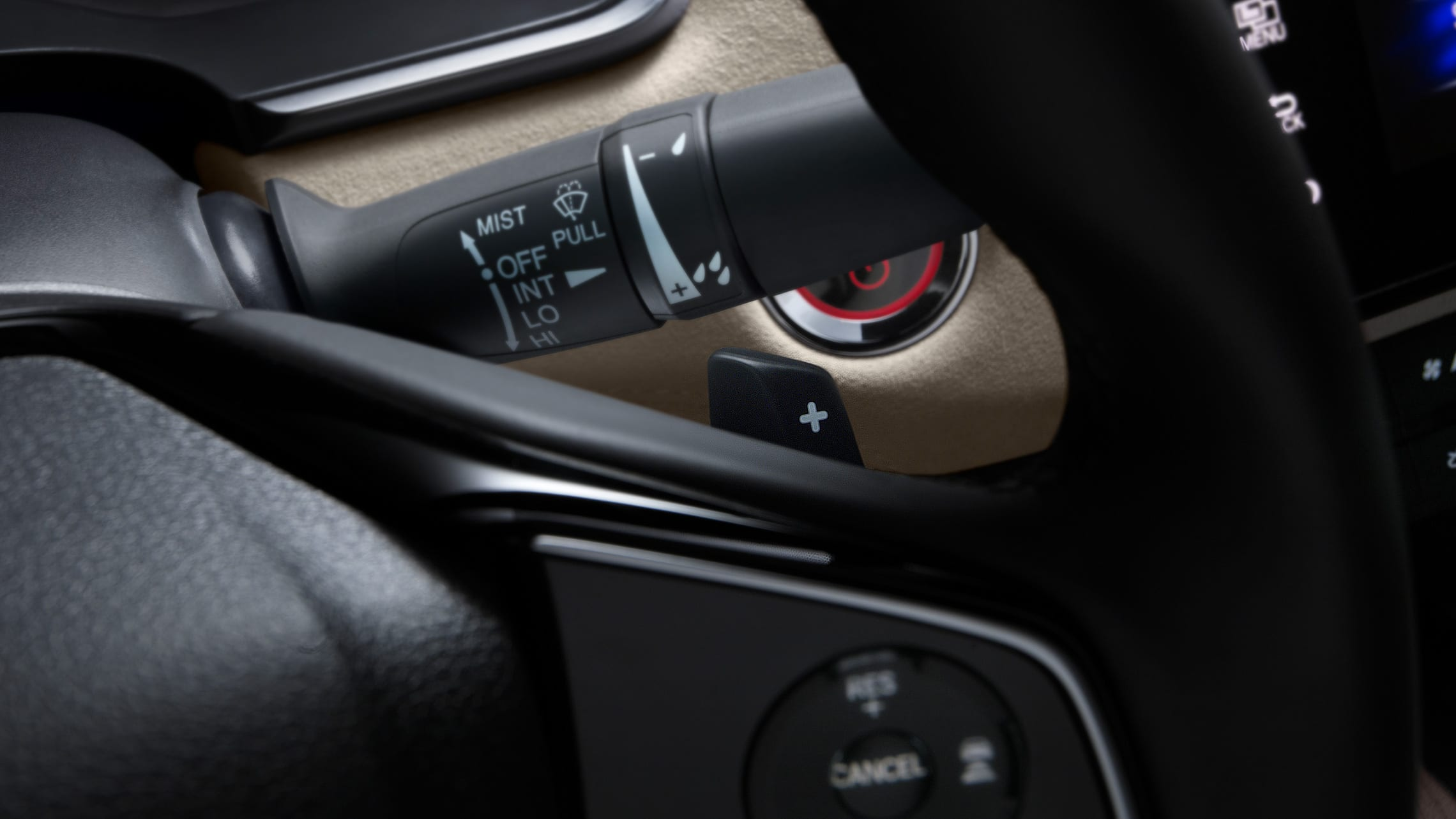Detail of steering wheel-mounted deceleration selectors in 2020 Clarity Plug-In Hybrid.