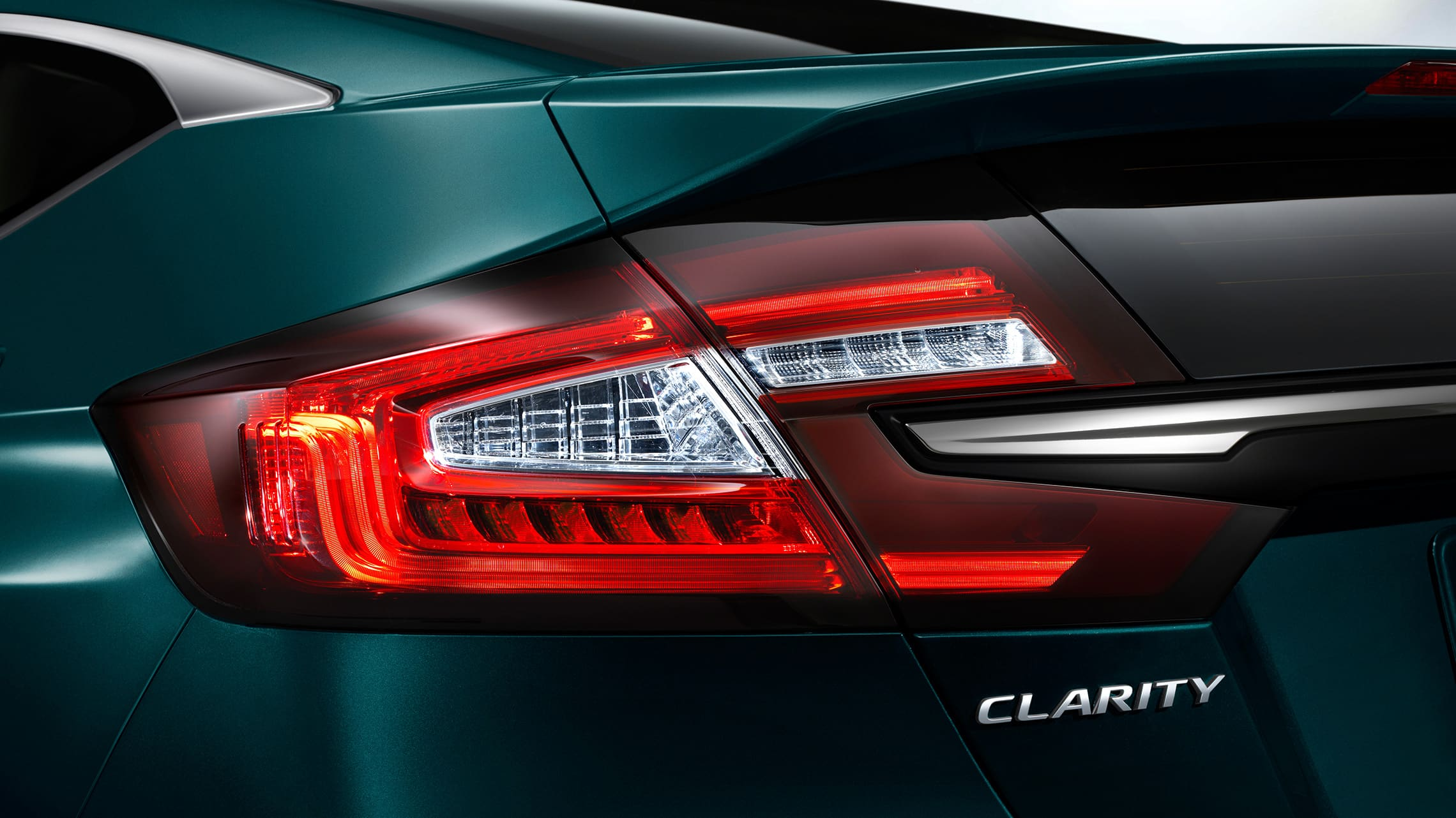 Detail of LED taillights on 2020 Clarity Plug-In Hybrid in Moonlit Forest Pearl.