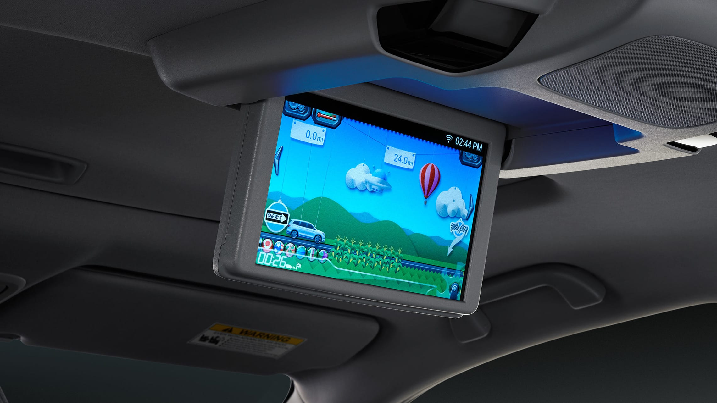 10.2-inch monitor for Advanced Rear Entertainment System detail display in 2021 Honda Pilot Elite with Gray Leather interior.